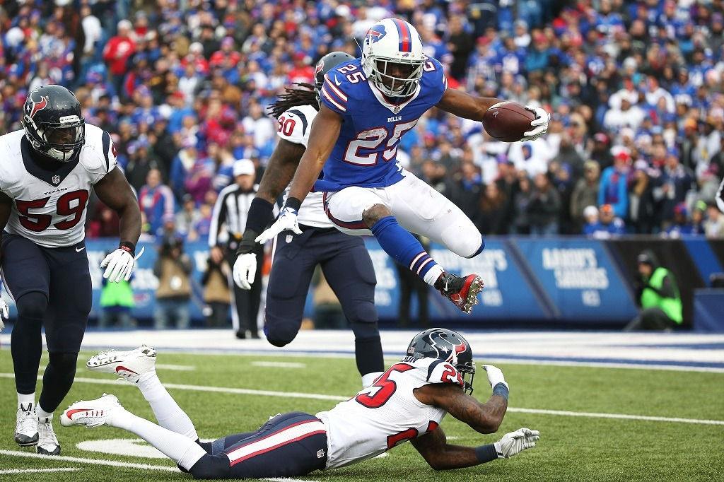ORCHARD PARK, NY - DECEMBER 06: LeSean McCoy #25 of the Buffalo Bills hurdles Kareem Jackson #25 of the Houston Texans during the second half at Ralph Wilson Stadium on December 6, 2015 in Orchard Park, New York. (Photo by Tom Szczerbowski/Getty Images)