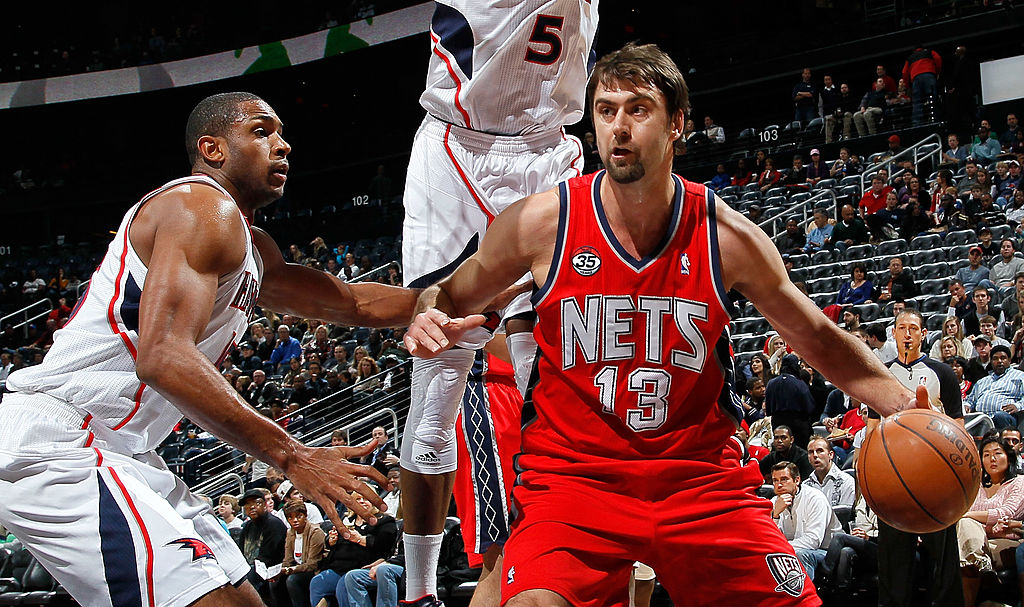Al Horford of the Atlanta Hawks against Mehmet Okur of the New Jersey Nets battle on the court.