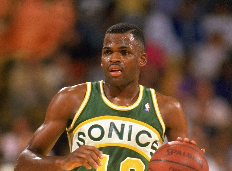 Nate McMillan of the Seattle Supersonics dribbles the basketball down the court.
