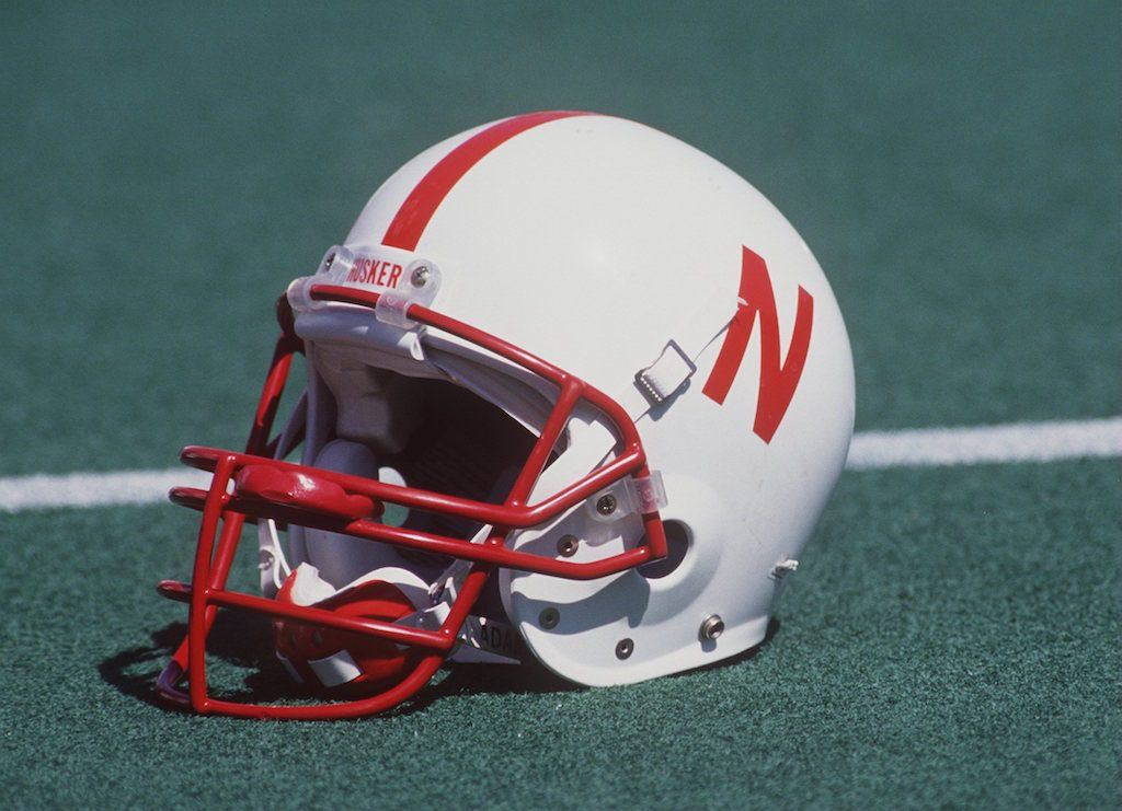 A Nebraska helmet rests on the field.
