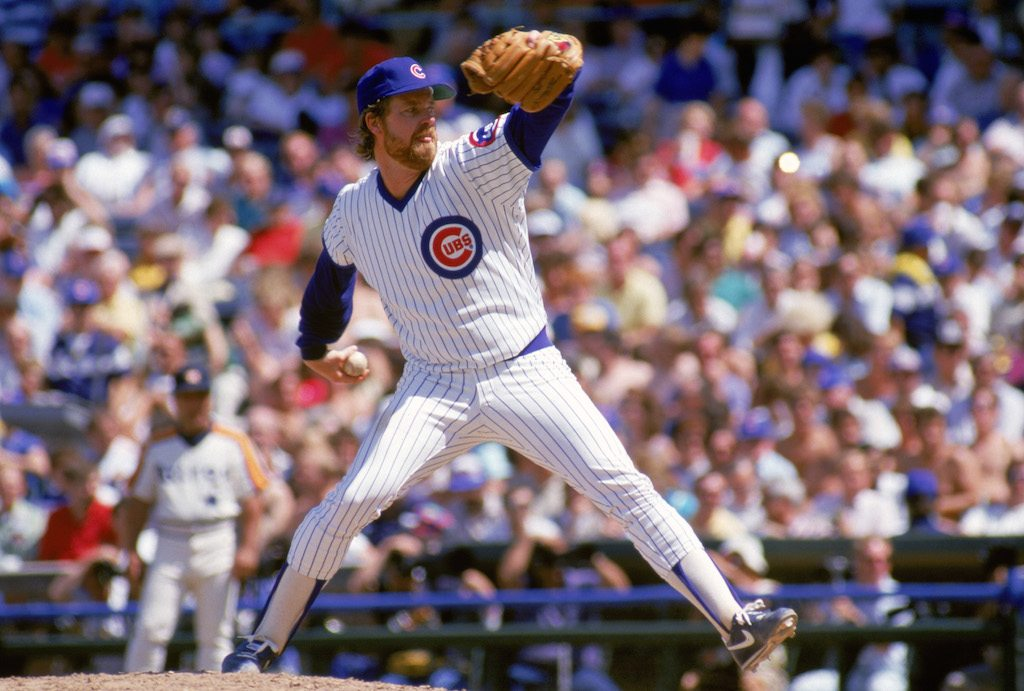 Rick Sutcliffe #40 of the Chicago Cubs winds back to pitch during a game in the 1987 season at Wrigley Field in Chicago, Illinois