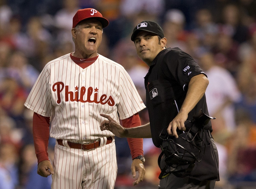 PHILADELPHIA, PA - JUNE 13: Manager Ryne Sandberg #23 of the Philadelphia Phillies is ejected in the top of the sixth inning by home plate umpire Mark Ripperger #90 after Phillies pitcher Roberto Hernandez #27 hit shortstop Starlin Castro #13 of the Chicago Cubs with a pitch on June 13, 2014 at Citizens Bank Park in Philadelphia, Pennsylvania. (Photo by Mitchell Leff/Getty Images)