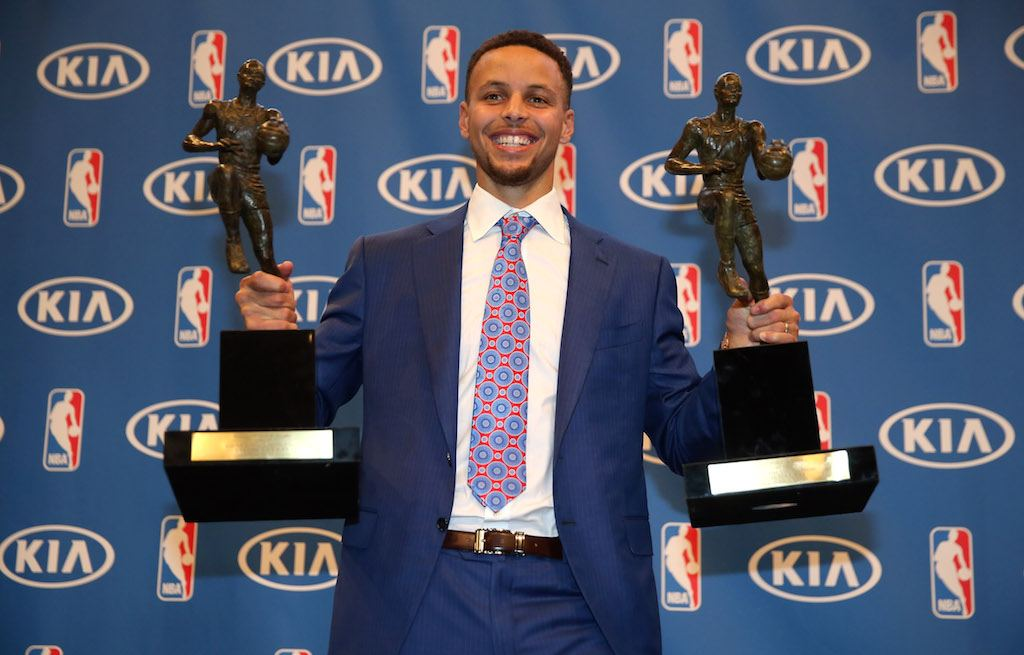 Stephen Curry shows off his back-to-back MVP awards for 2015 and 2016.