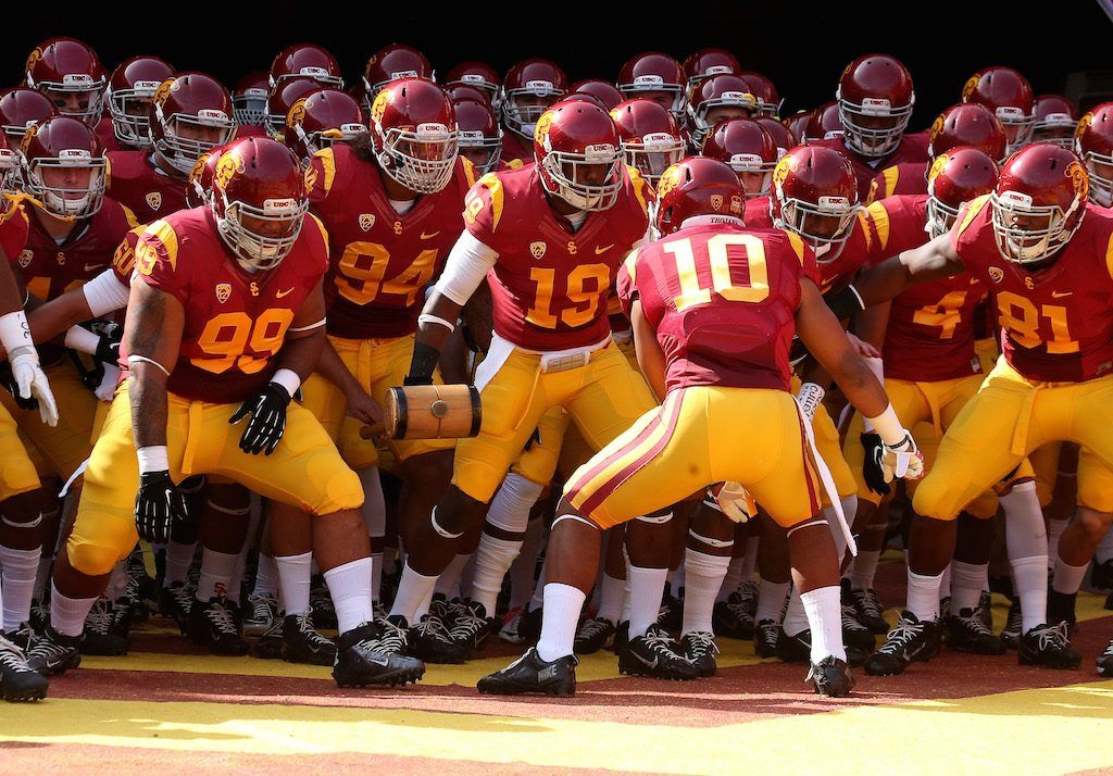 The USC Trojans get pumped up before a game.