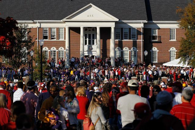 Alabama fans walk around campus before the game.