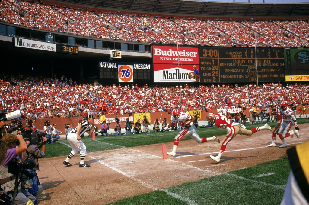 Candlestick in its heyday, as running back James Primus of the Atlanta Falcons rushes for a touchdown past cornerback Don Griffin.
