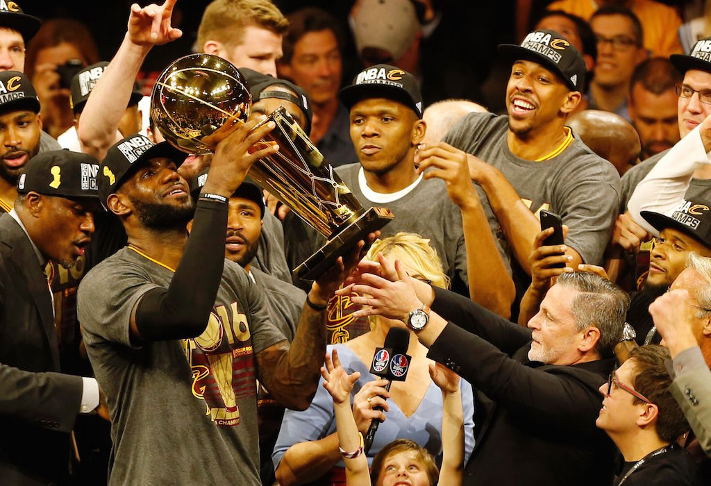 LeBron James and the Cavaliers hoist the Larry O'Brien Championship Trophy.