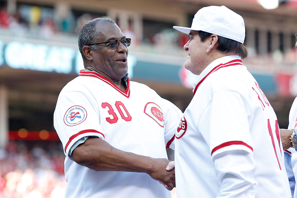 Cincinnati Reds greats Ken Griffey and Pete Rose shake hands during a ceremony honoring the 1976 World Series Championship