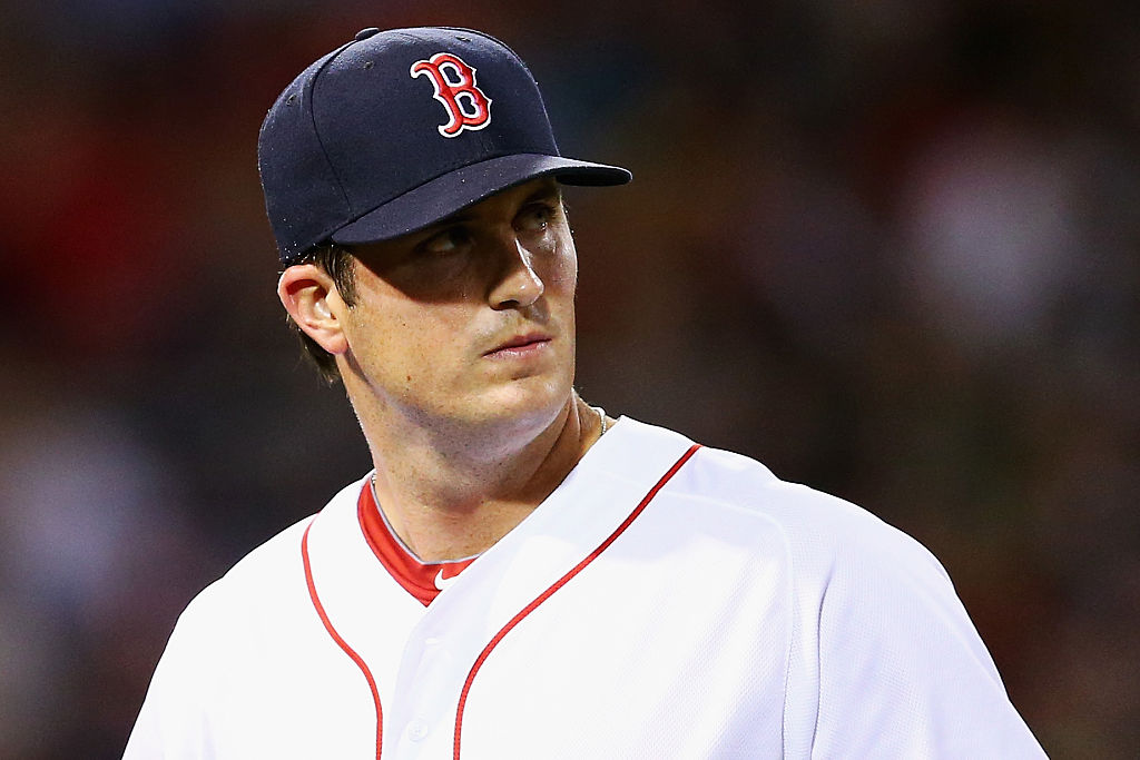 Drew Pomeranz #31 of the Boston Red Sox returns to the dugout after being relieved during the seventh inning against the Tampa Bay Rays at Fenway Park on August 30, 2016 in Boston, Massachusetts.