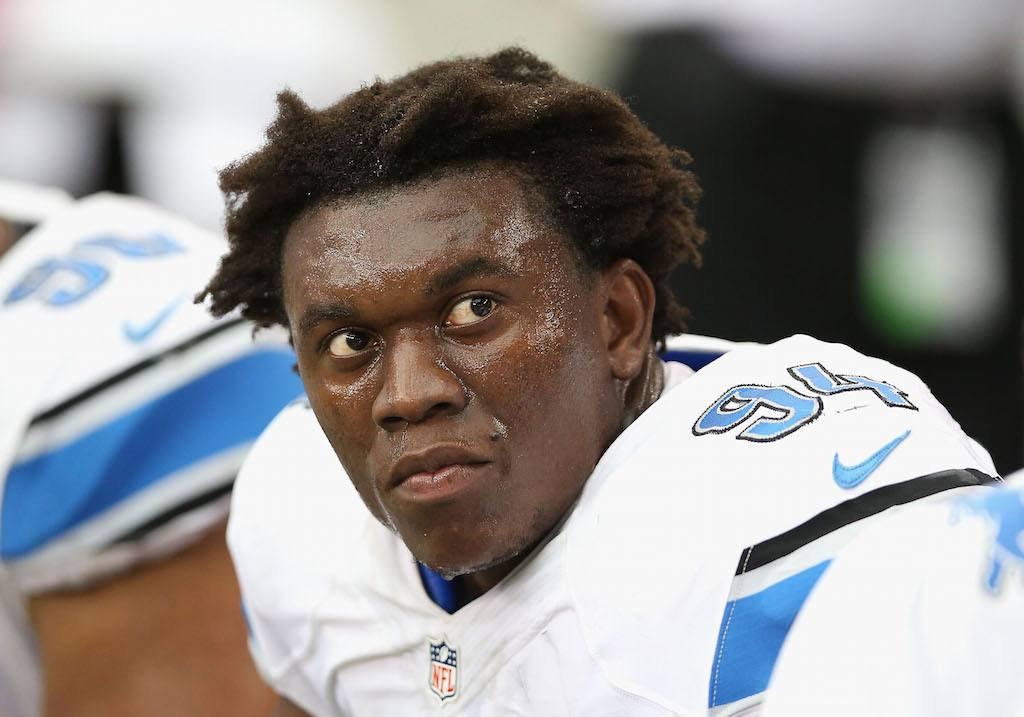 "Detroit Lions defensive end Ezekiel ""Ziggy"" Ansah rests during a game."