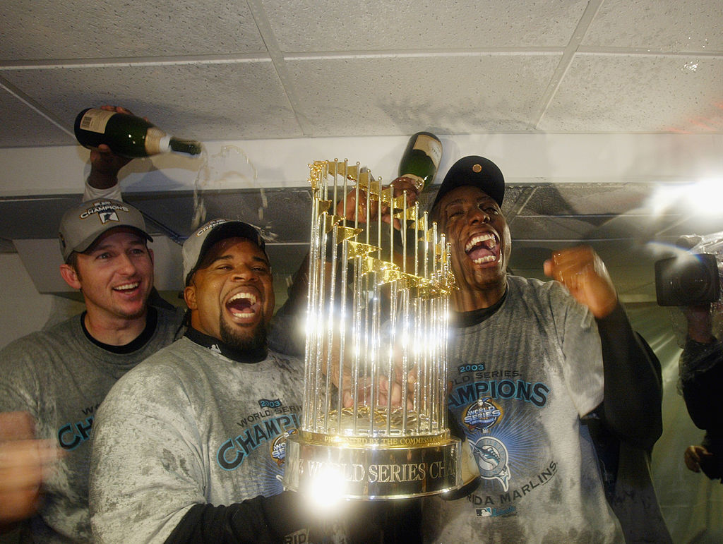 Florida Marlins players celebrate with the World Series Trophy after defeating the New York Yankees in game six of the Major League Baseball World Series on October 25, 2003 at Yankee Stadium in the Bronx, New York. The Marlins won 2-0.