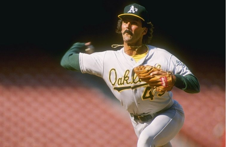 Pitcher Dennis Eckersley of the Oakland Athletics prepares to throw the ball.