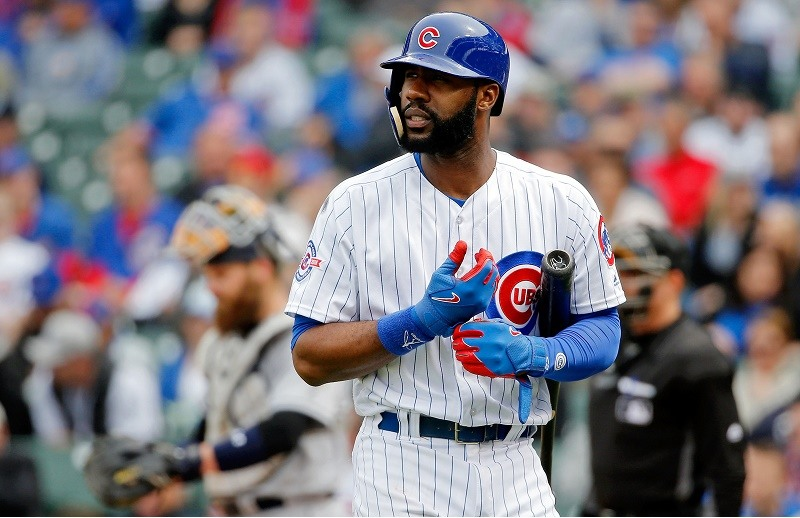 Jason Heyward of the Chicago Cubs walks off the field after striking out.