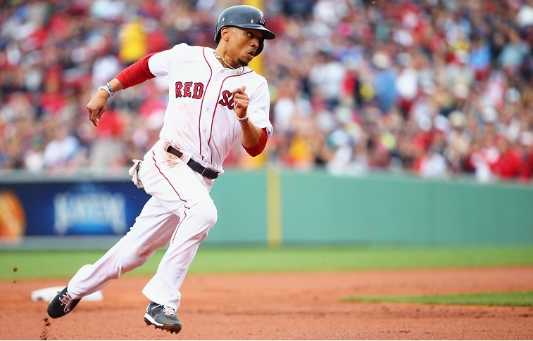 BOSTON, MA - JULY 10: Mookie Betts #50 of the Boston Red Sox rounds second during the first inning against the Tampa Bay Rays at Fenway Park on July 10, 2016 in Boston, Massachusetts.