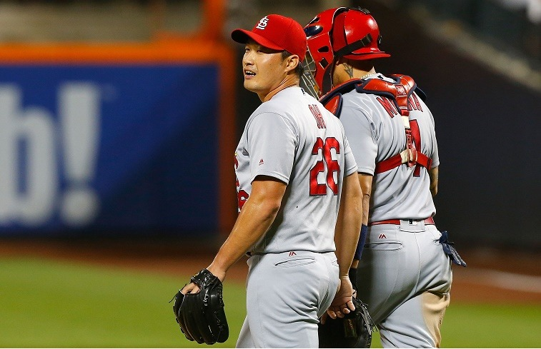 NEW YORK, NY - JULY 27: Seung Hwan Oh #26 and Yadier Molina #4 of the St. Louis Cardinals celebrate after defeating the New York Mets at Citi Field on July 27, 2016 in the Flushing neighborhood of the Queens borough of New York City.