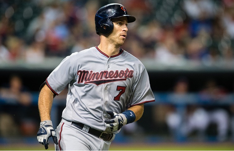 The Minnesota Twins infielder Joe Mauer rounds the bases on a solo home run.
