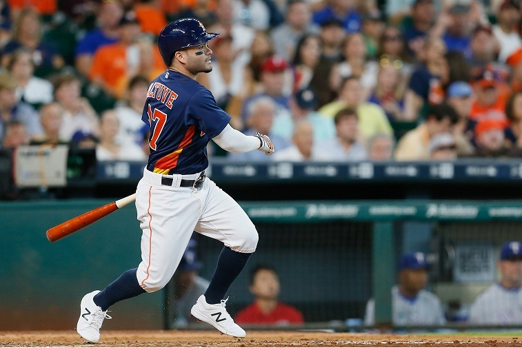 HOUSTON, TX - AUGUST 07: Jose Altuve #27 of the Houston Astros singles in the sixth inning against the Texas Rangers at Minute Maid Park on August 7, 2016 in Houston, Texas.