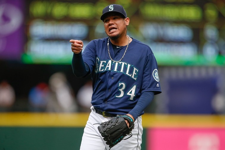 Starting pitcher Felix Hernandez of the Seattle Mariners points toward home after giving up a walk.