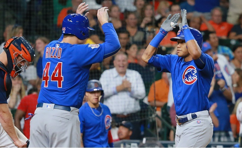 Anthony Rizzo and Addison Russell high five.