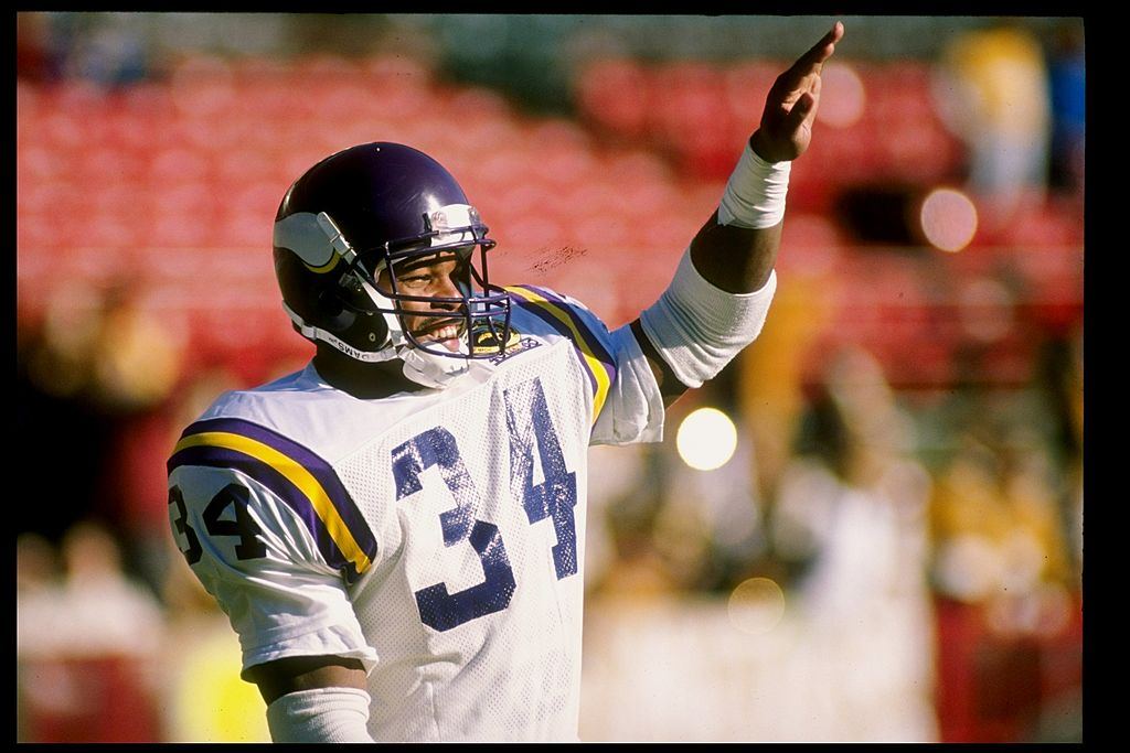 Running back Herschel Walker of the Minnesota Vikings looks on during a game against the Green Bay Packers.