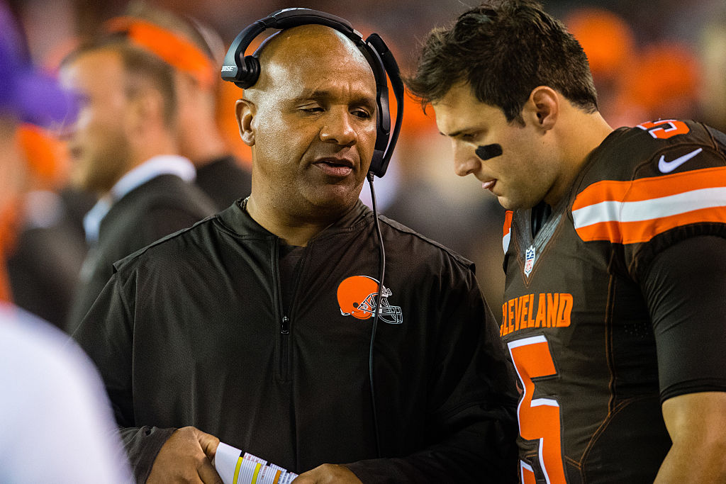 Head coach Hue Jackson talks with quarterback Cody Kessler of the Cleveland Browns.