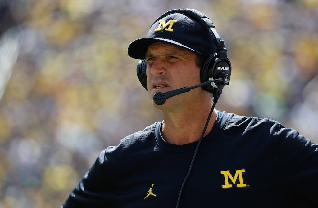 Jim Harbaugh looks on during a game
