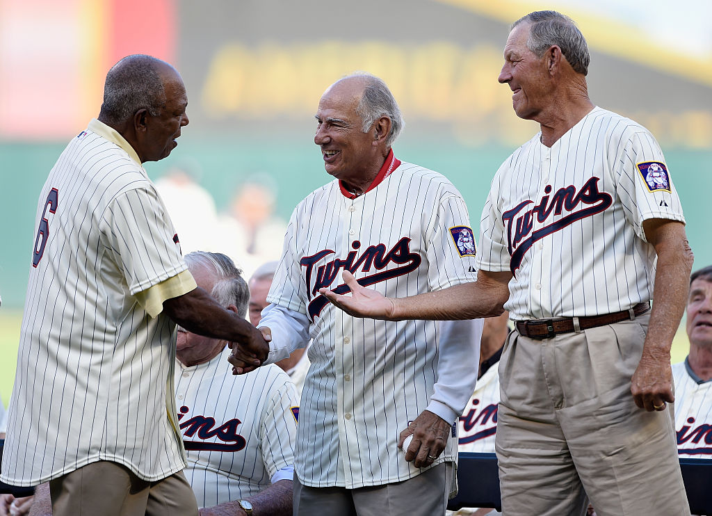 MINNEAPOLIS, MN - AUGUST 1: Tony Oliva, former player with the Minnesota Twins, shakes hands with former teammates Frank Quilici and Jim Kaat during a ceremony honoring the 1965 American League Championship team before the game between the Minnesota Twins and the Seattle Mariners on August 1, 2015 at Target Field in Minneapolis, Minnesota. (Photo by Hannah Foslien/Getty Images)