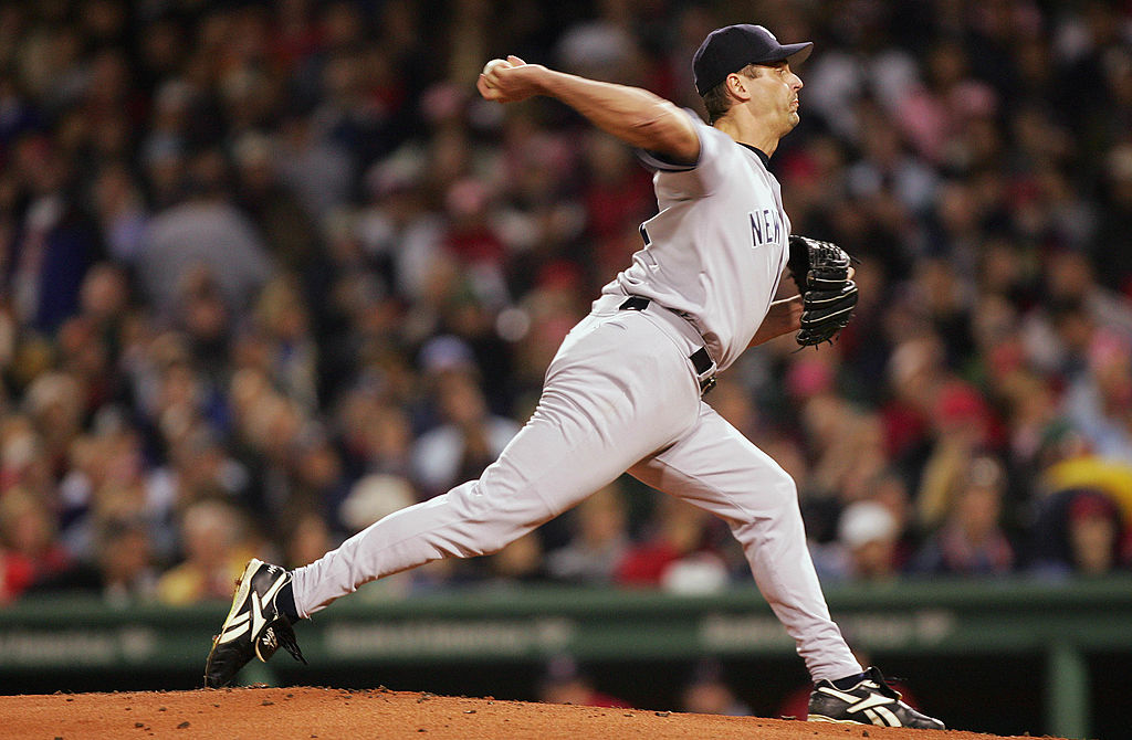 BOSTON - OCTOBER 16: Pitcher Kevin Brown #27 of the New York Yankees throws a pitch against the Boston Red Sox in the first inning during game three of the American League Championship Series on October 16, 2004 at Fenway Park in Boston, Massachusetts. (Photo by Ezra Shaw/Getty Images)