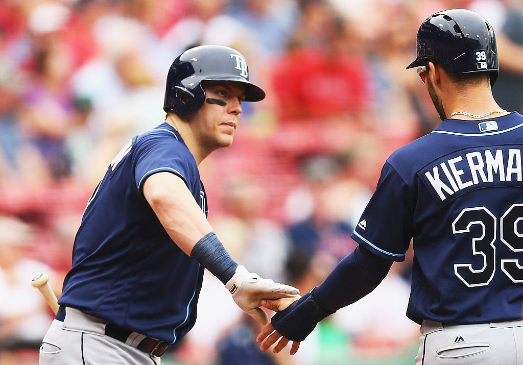 Logan Morrison of the Tampa Bay Rays congratulates Kevin Kiermaier after he scores.