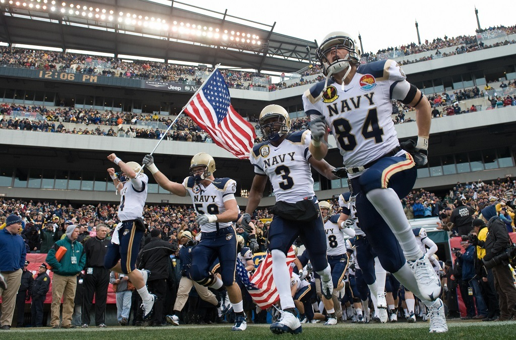Members of the Navy football team run out onto the field prior to the Army vs. Navy football game attended by US President George W. Bush at Lincoln Financial Field in Philadelphia, Pennsylvania, on December 6, 2008. AFP PHOTO / Saul LOEB (Photo credit should read SAUL LOEB/AFP/Getty Images)
