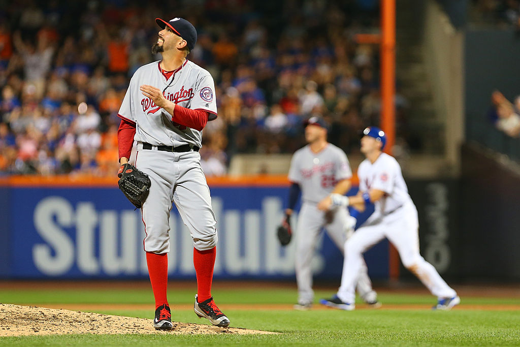 Oliver Perez of the Washington Nationals watches Wilmer Flores of the New York Mets three run home run in the fifth inning at Citi Field on July 7, 2016 in the Flushing neighborhood of the Queens borough of New York City.