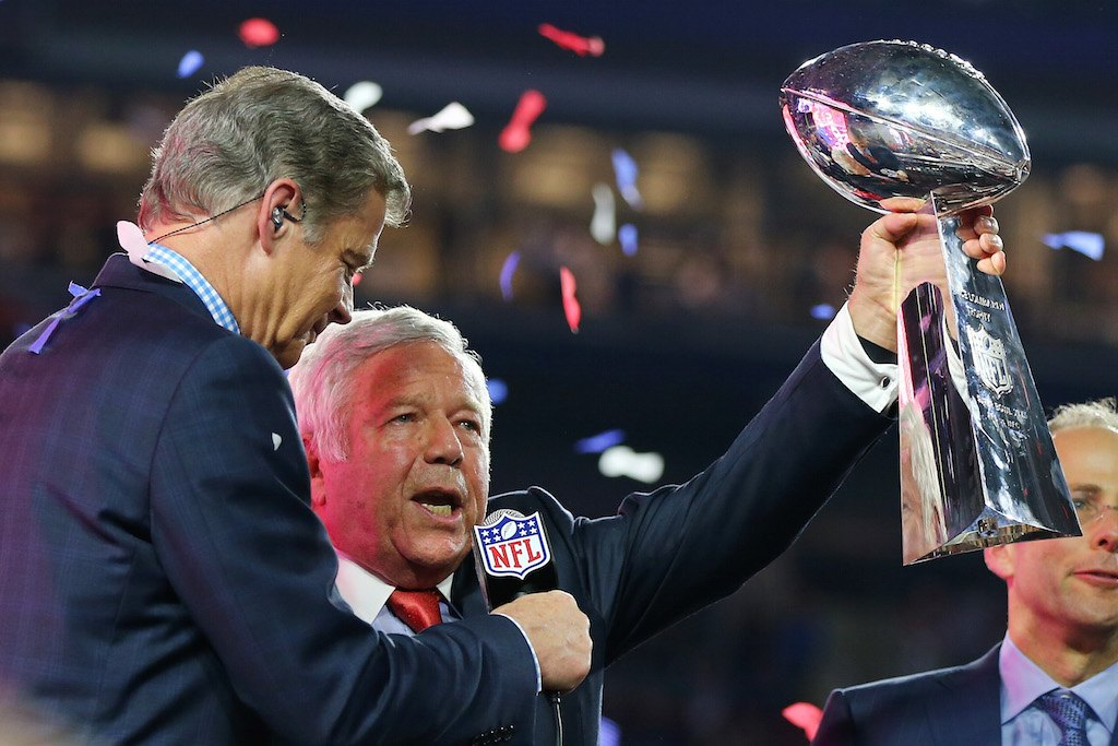 Patriots owner Robert Kraft hoists the Lombardi Trophy.