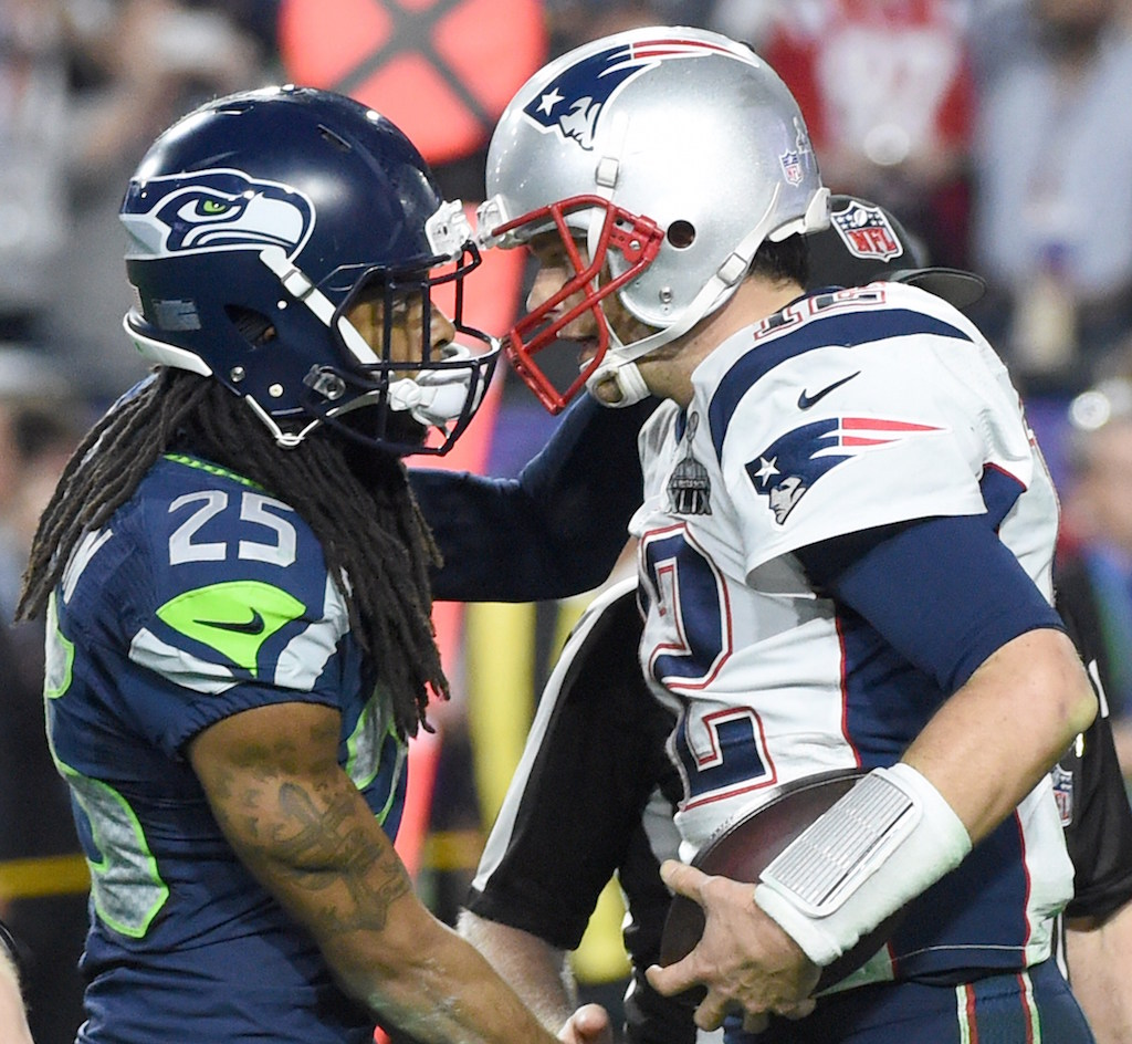 Richard Sherman of the Seattle Seahawks congratulates New England Patriots quarterback Tom Brady after Super Bowl XLIX.