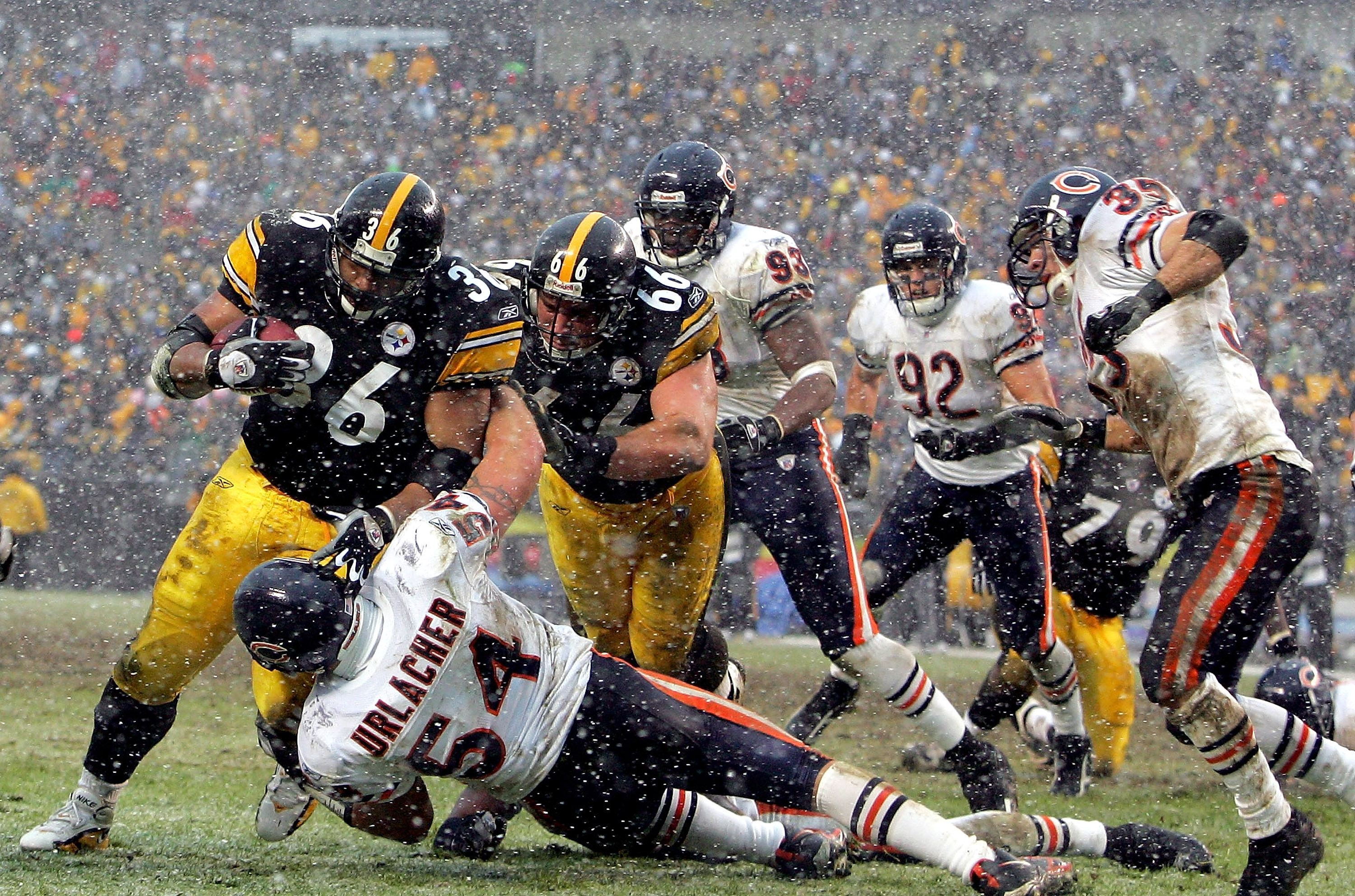 Jerome Bettis of the Pittsburgh Steelers runs over Brian Urlacher the Chicago Bears for a touchdown.