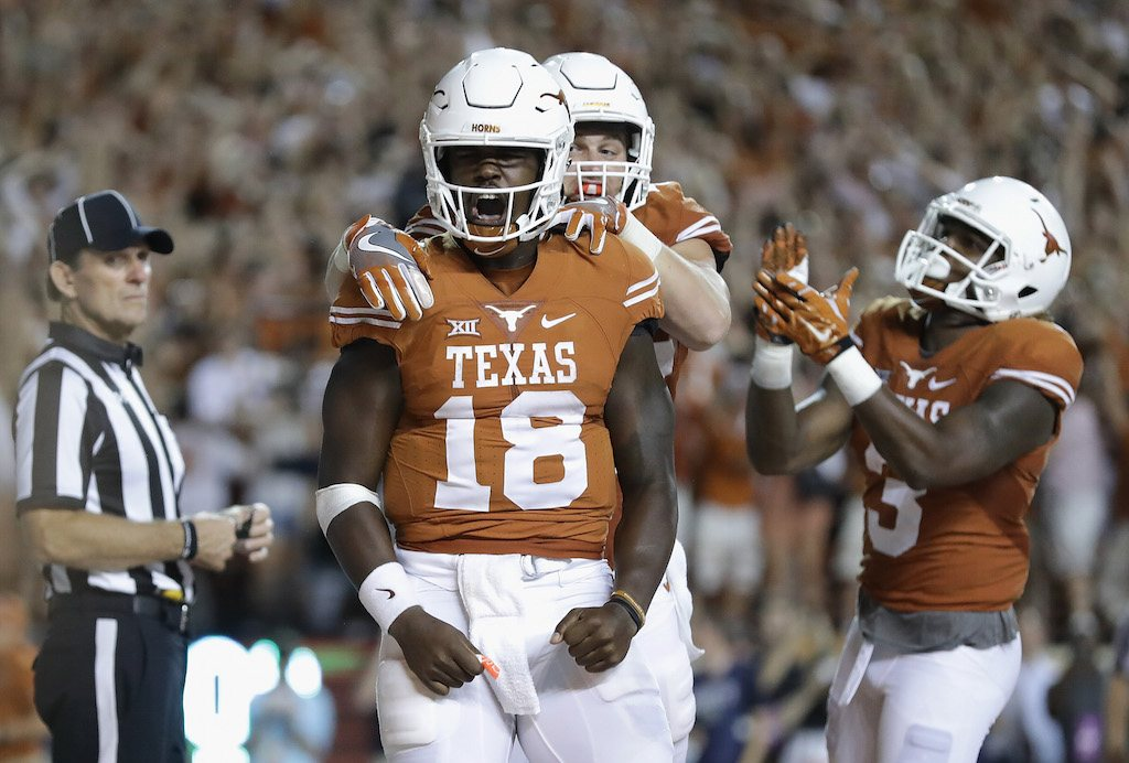 Tyrone Swoopes of the Texas Longhorns celebrates with his teammates.