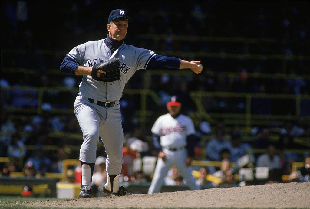 Tommy John #25 of the New York Yankees throws to first base during a 1989 season game