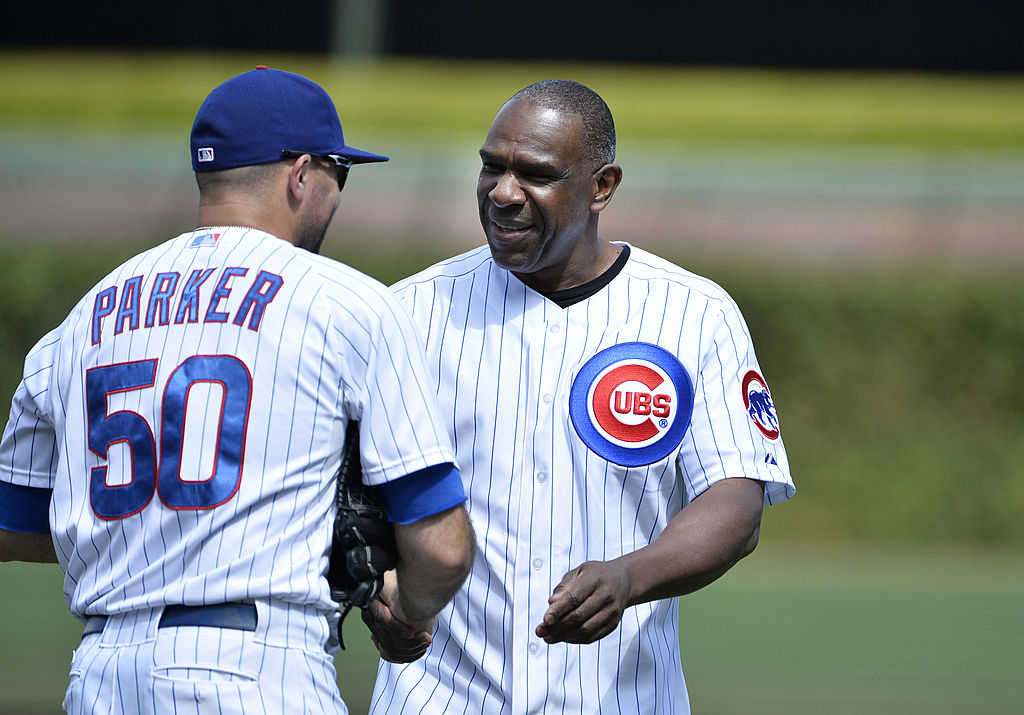 Former Chicago Cub Andre Dawson (R) shakes hands with Blake Parker #50 of the Chicago Cubs