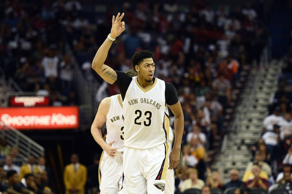 Anthony Davis motions to his teammates.