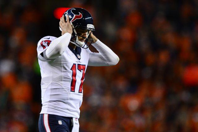 Quarterback Brock Osweiler of the Houston Texans removes his helmet after a tough loss | Dustin Bradford/Getty Images