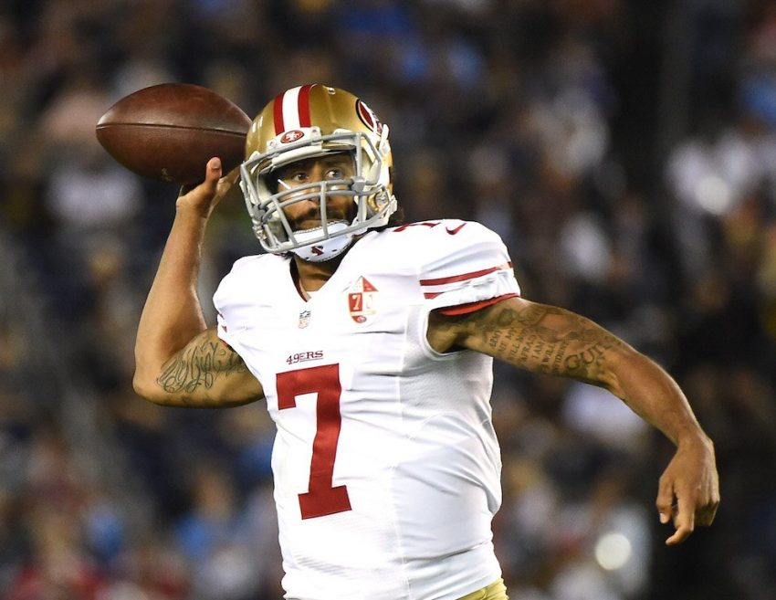 Colin Kaepernick does work in the preseason | Harry How/Getty Images
