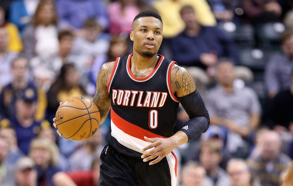 Damian Lillard dribbles toward the basket.
