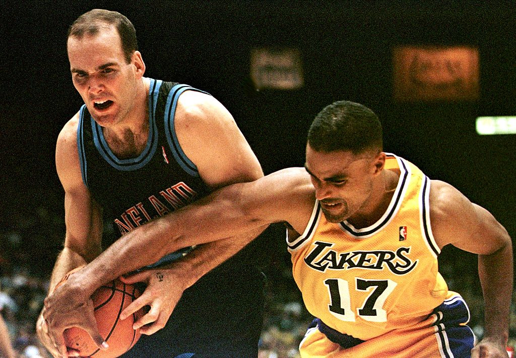 Cleveland Cavaliers' Danny Ferry takes a foul against the Lakers.
