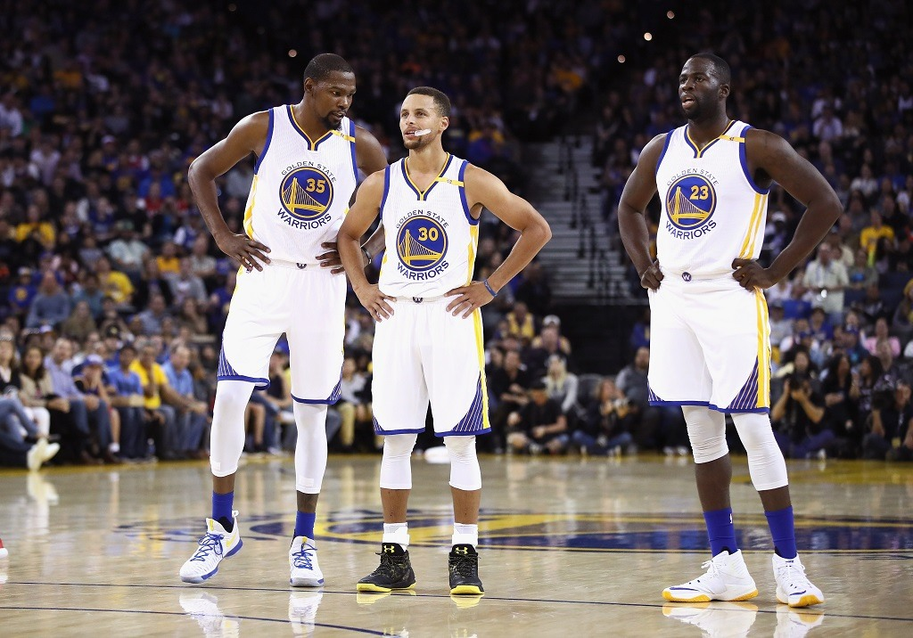 Kevin Durant #35, Stephen Curry #30, and Draymond Green #23 of the Golden State Warriors