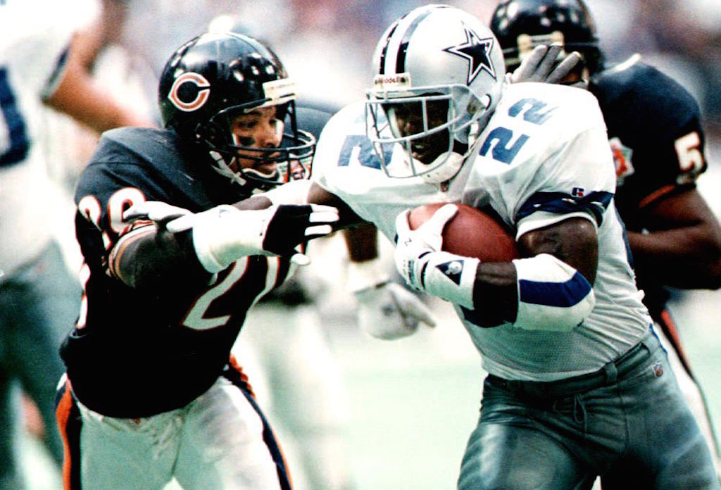 Emmitt Smith tries to get ahead of a defender.