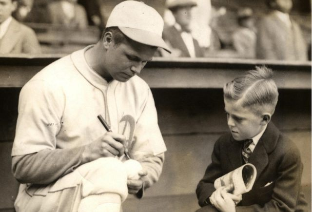 Philadelphia A's Jimmie Foxx with young fan in 1930