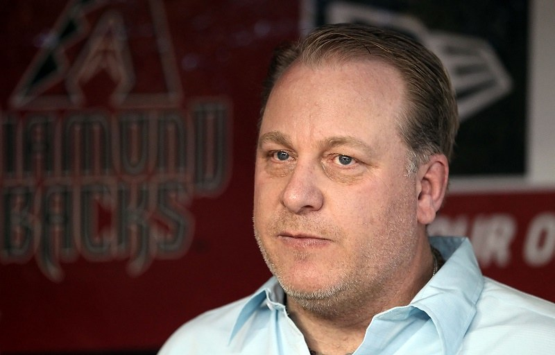 PHOENIX, AZ - SEPTEMBER 10: Curt Schilling, former member of the 2001 Arizona Diamondbacks World Series team walks in the dugout before the Major League Baseball game against the San Diego Padres at Chase Field on September 10, 2011 in Phoenix, Arizona. The Diamondbacks are celebrating the 10th anniversary of their World Series title.