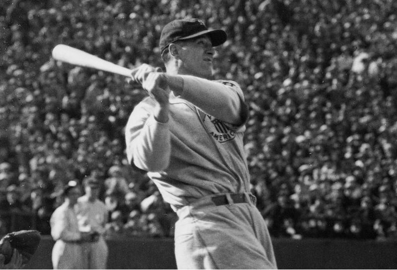 circa 1930: Baseball star Lou Gehrig (1903 - 1941) at the moment of his home-run hit at his game between Major League and All Japan.