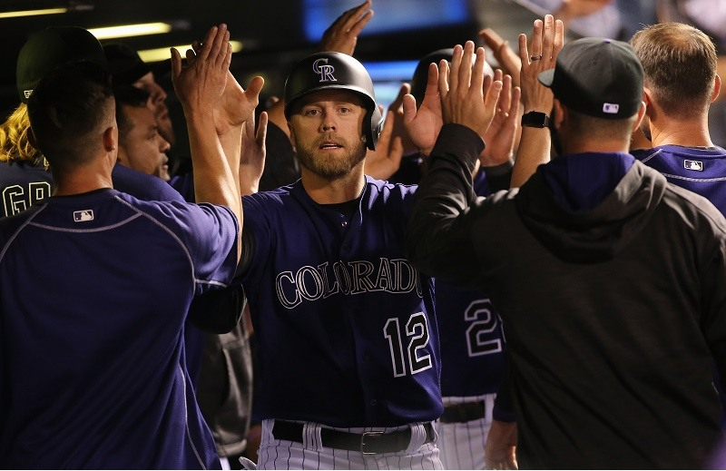 The Colorado Rockies high five after a home run.