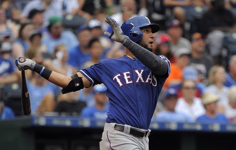 Texas Rangers outfielder Nomar Mazara watches as his home run leaves the park.