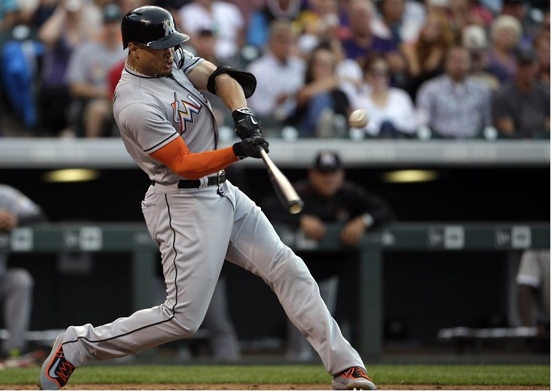 DENVER, CO - AUGUST 06: Giancarlo Stanton #27 of the Miami Marlins hits a fly ball to center in the third inning at Coors Field on August 6, 2016 in Denver, Colorado. (Photo by Joe Mahoney/Getty Images)